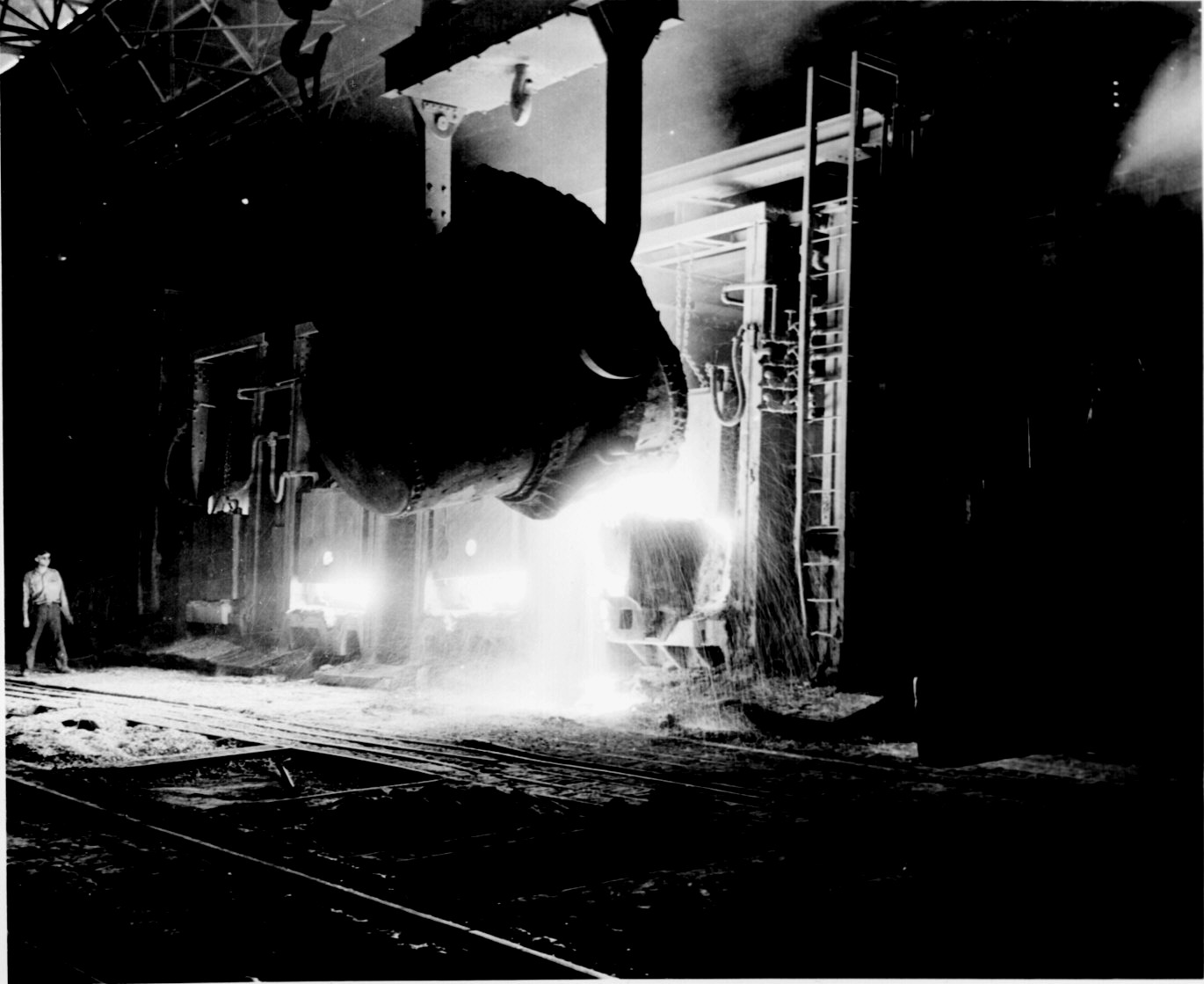 Photo: A huge ladle of molten pig iron being poured into an open hearth furnace at the Jones and Laughlin Steel Company, Pittsburgh, May 1942.