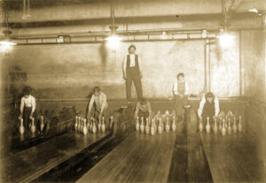 1:00 A.M. Pin boys working in Subway Bowling Alleys, 65 South St., B'klyn, N.Y. every night. 3 smaller boys were kept out of the photo by Boss. Location: New York--Brooklyn, New York (State).