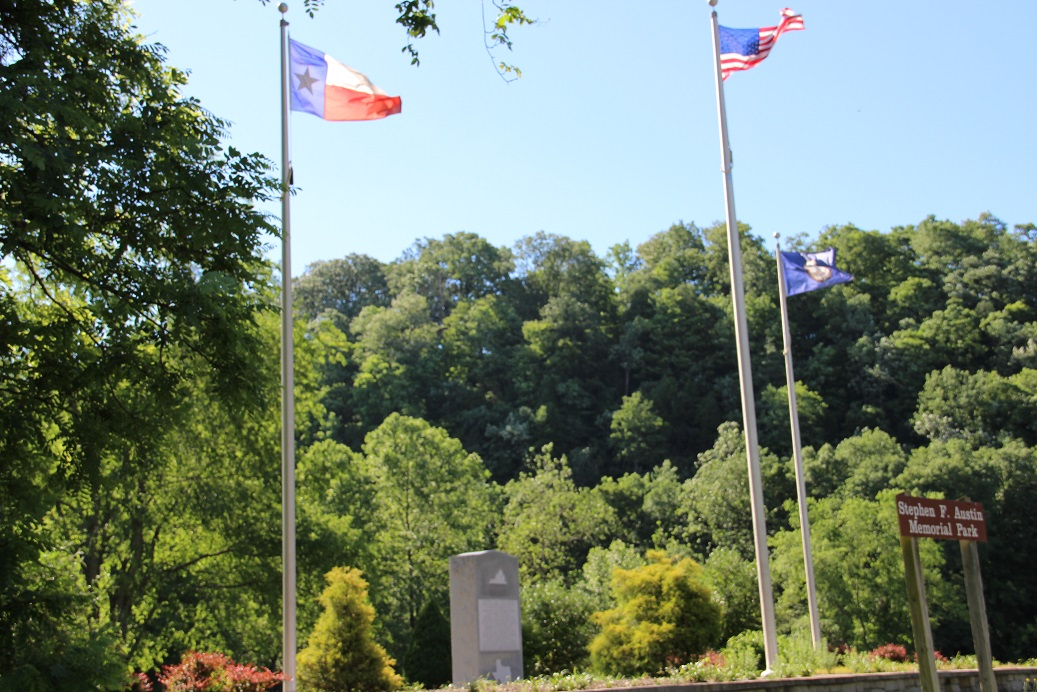 PHOTO: Texas Flag flies over the banks of the New River in Wythe County, Virginia, at the birthplace site of Stephen F. Austin, Father of Texas