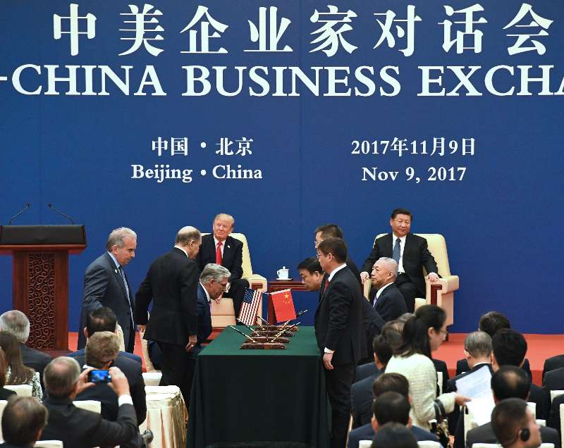 PHOTO: President Donald Trump and Chinese President Xi Jinping witnessed West Virginia Secretary of Commerce Woody Thrasher and China Energy President Ling Wen sign a Memorandum of Understanding between China Energy and the state of West Virginia as part of the US-China Business Exchange trade mission to enhance relations between the two countries.