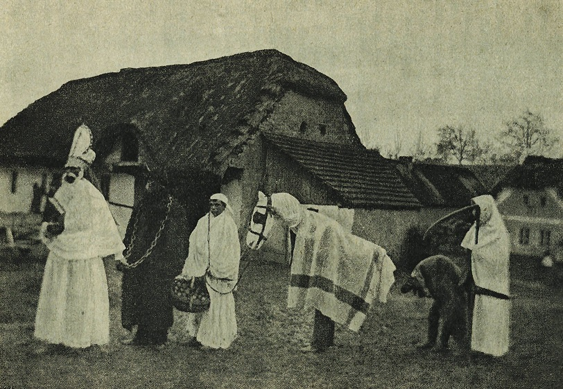 A St. Nicholas procession with Krampus, and other characters, c. 1910