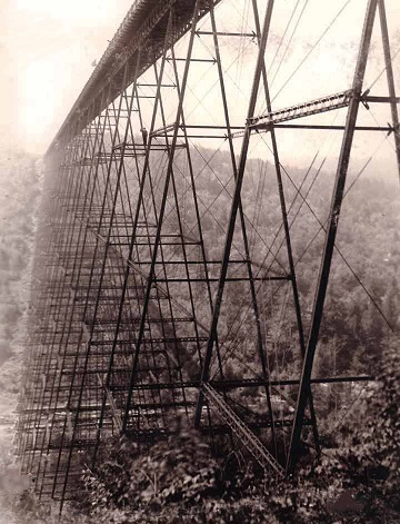 PHOTO: Original bridge, shortly after construction. Notice the man standing in the span.