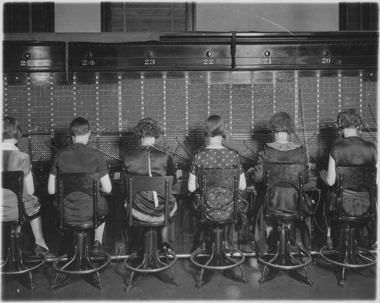 Photo: Chesapeake and Potomac Telephone Company. View of row of operators. View of chairs showing type of chairs used by telephone company. Courtesy of Department of Labor. Women's Bureau.