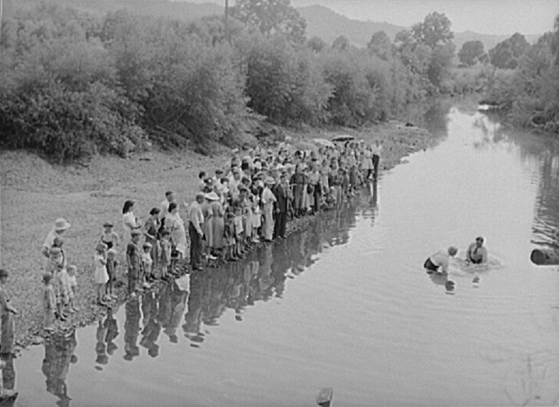 Photo: Members of the Primitive Baptist Church in Morehead, Kentucky, attending a creek baptizing by submersion, 1940. Courtesy, Farm Security Administration photograph by Marion Post Wolcott.
