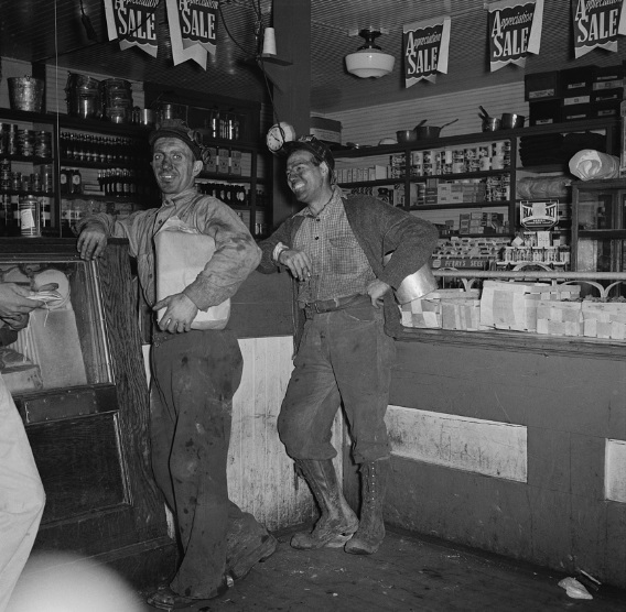 Coal miners buying groceries in company store. Pursglove, West Virginia. Sept. 1938.