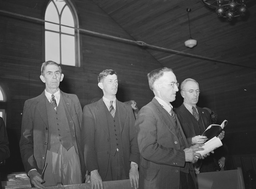 Elders singing hymn at Baptist church near project. Dailey, West Virginia. Dec. 1941