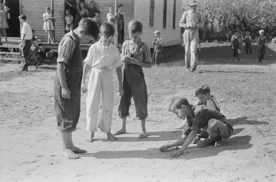 Wolcott, Marion Post, photographer. Mountain children playing marbles after school in Breathitt County, Kentucky. [Sept.?] Photograph. Retrieved from the Library of Congress, .