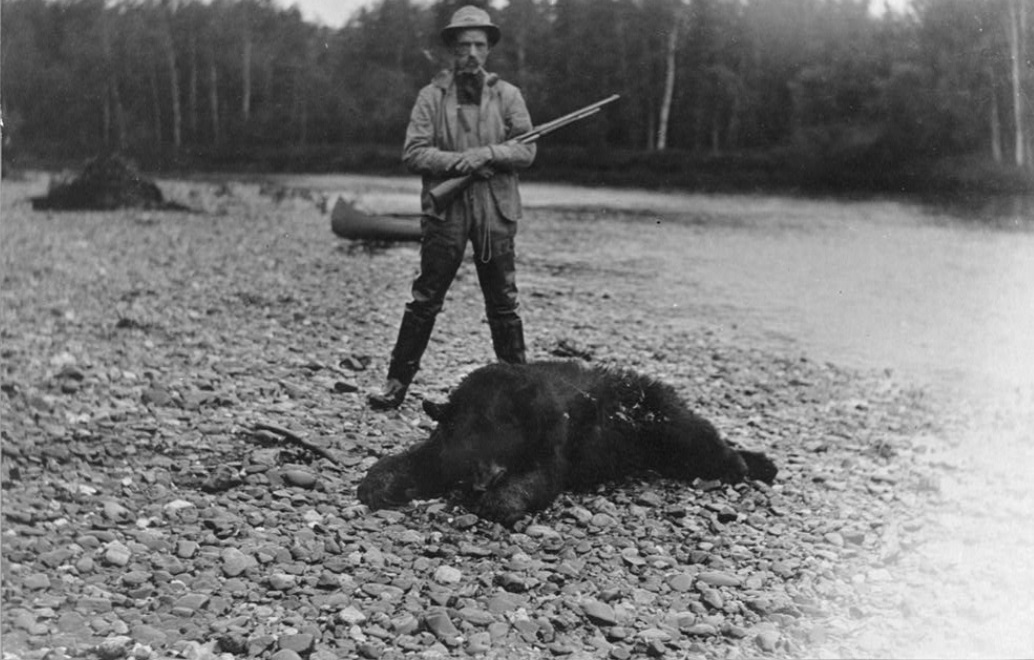 Hunter with bear which he killed [between ca. 1900 and 1927]