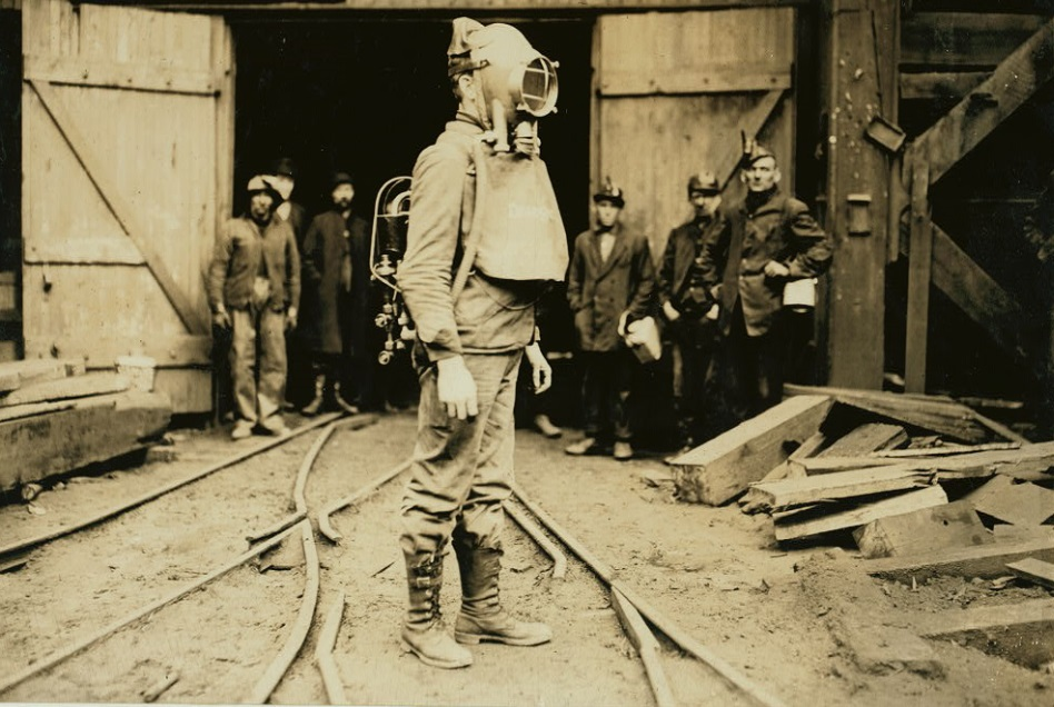 Photo: January 1911, Pennsylvania; Mine rescuer wearing an early oxygen mask known as the Draeger Oxygen Helmet.